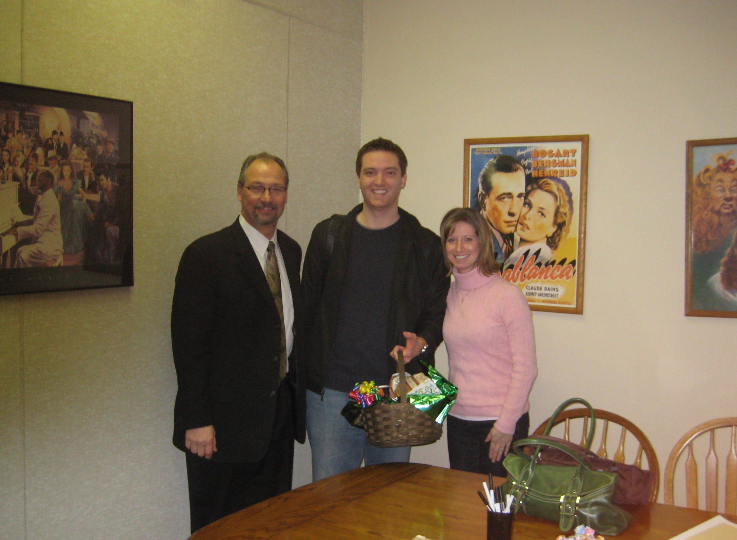 Happy couple with Larry Swinden